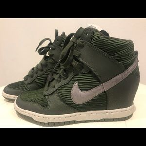 Olive green Nike high tops. Silver swoosh